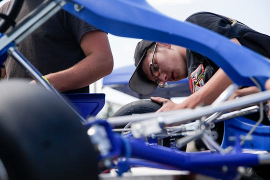 Malik Cornett of Jennings torques a tire on his teams cart before the evGrand Prix, Wednesday, Aug. 28, 2019 at the Purdue Grand Prix Track in West Lafayette.