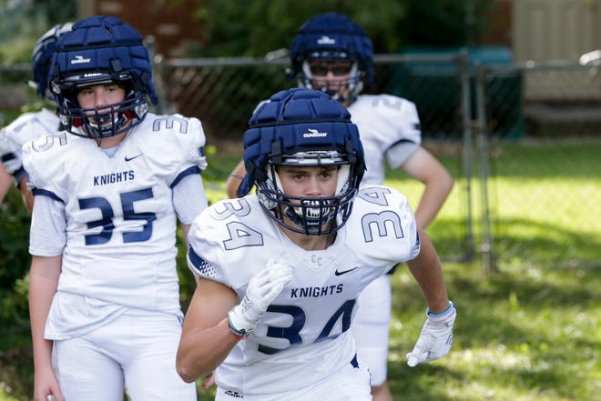 Central Catholic's Tommy Puskar (34) runs through a drill during a football practice, Tuesday, Aug. 27, 2019 in Lafayette.