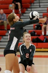 West Lafayette's Alex Dexter (6) hits the ball over West Lafayette's Jenna Chesterman (2) during the second set of an IHSAA volleyball game, Tuesday, Aug. 27, 2019 in West Lafayette. West Lafayette won, 3-0(25-12, 25-20, 25-9).