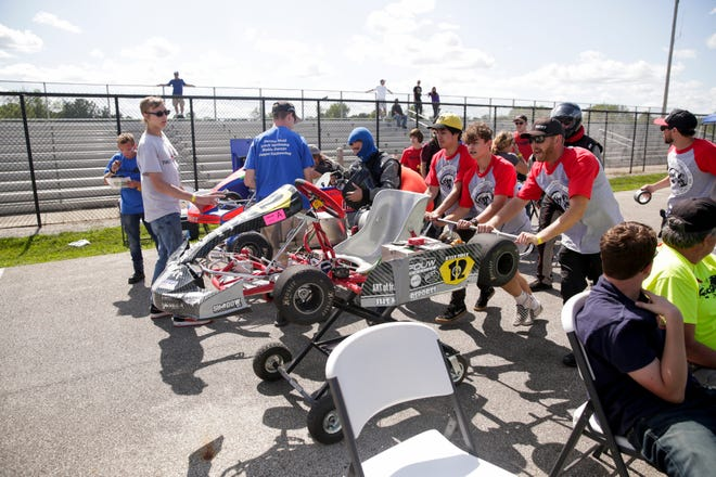 The Lafayette Jeff 12 cart is rushed through pit lane during a pit stop during the evGrand Prix, Wednesday, Aug. 28, 2019 at the Purdue Grand Prix Track in West Lafayette.