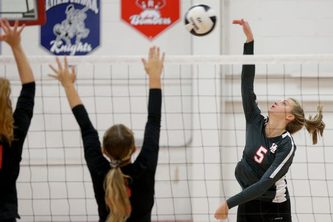 West Lafayette's Tori Woods (5) spikes the ball over the net during the third set of an IHSAA volleyball game, Tuesday, Aug. 27, 2019 in West Lafayette. West Lafayette won, 3-0(25-12, 25-20, 25-9).