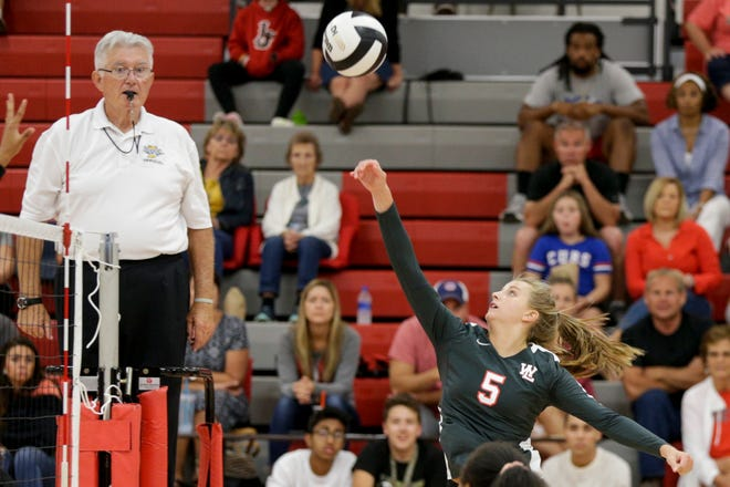 West Lafayette's Tori Woods (5) hits the ball over the net during the third set of an IHSAA volleyball game, Tuesday, Aug. 27, 2019 in West Lafayette. West Lafayette won, 3-0(25-12, 25-20, 25-9).