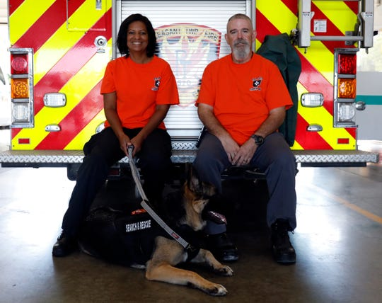 Jeaneene Crowell, left, and Greg Moore sit with Sasha at the back of a Pleasant Township Fire Department truck Wednesday morning, Aug. 28, 2019. Sasha, a search and recovery dog, is a member of the Ohio Rescue Dog Association and Pleasant Township Fire Department. Crowell is Sasha's owner and handler. Moore is the president of ORDA.