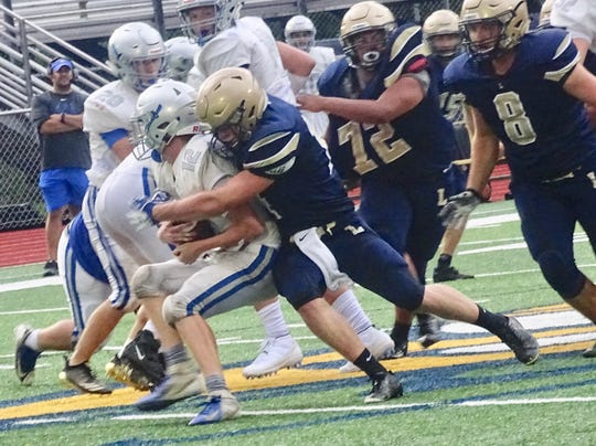 "Lancaster senior linebacker Curtis Young makes a tackle during the Golden Gales"" scrimmage against Central Crossing.  Lancaster opens the season Friday against Watterson at 7 p.m. at Fulton Field."