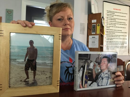 Michele Wagner, from Fowlerville, holds up pictures of her son Mitchell. He died of a heroin overdose in 2014. After his death, she started the organization Mitchell's Hope to help others with addiction. For the fifth consecutive year, she is hosting an event Saturday in Fowlerville for International Overdose Awareness Day.