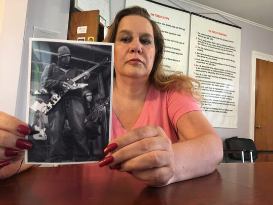Hartland resident Kelly Armstrong holds up a photo of her son Garrett, who died last year of a heroin overdose. She will be participating in the fifth annual International Overdose Awareness Day event on Saturday in Fowlerville.