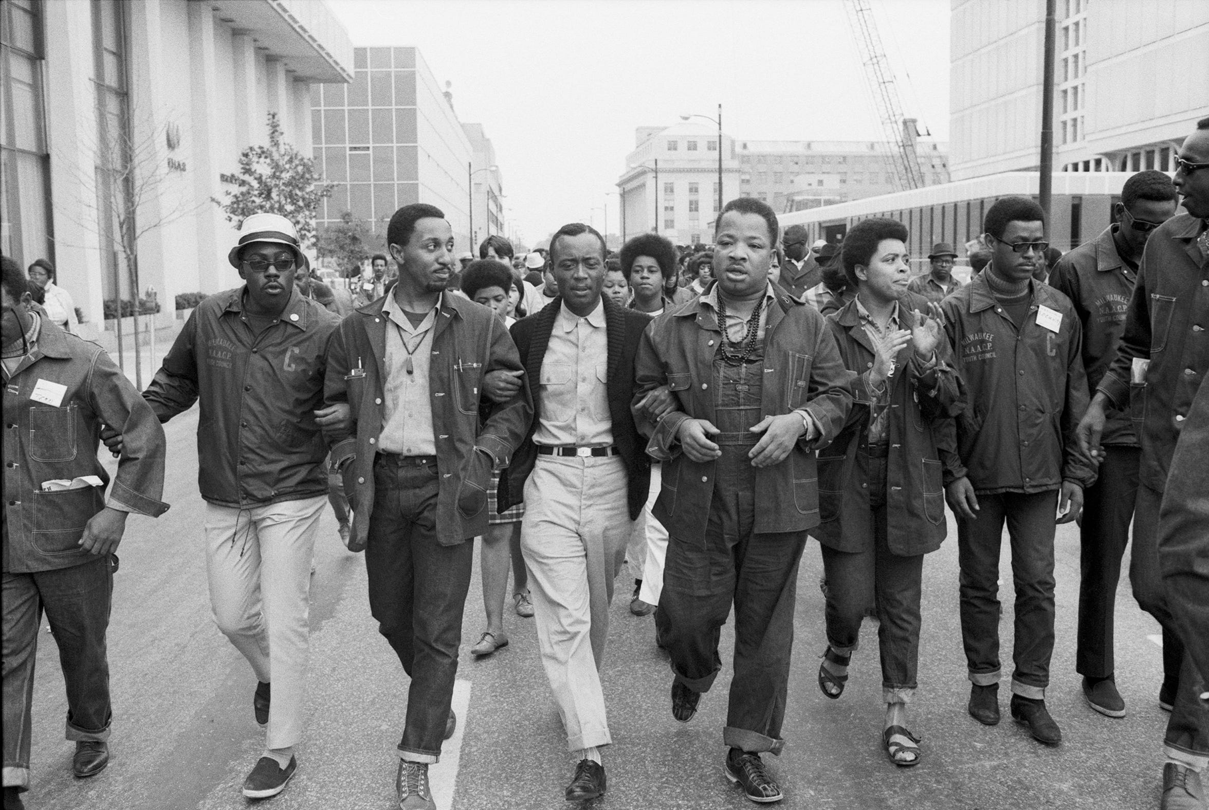 The Rev. Charles Elliott Jr., center, marched with Dr. Ralph Abernathy (in overalls), and members of the Milwaukee NAACP at the Poor People's March along Sixth Street in Louisville. May 10, 1968.