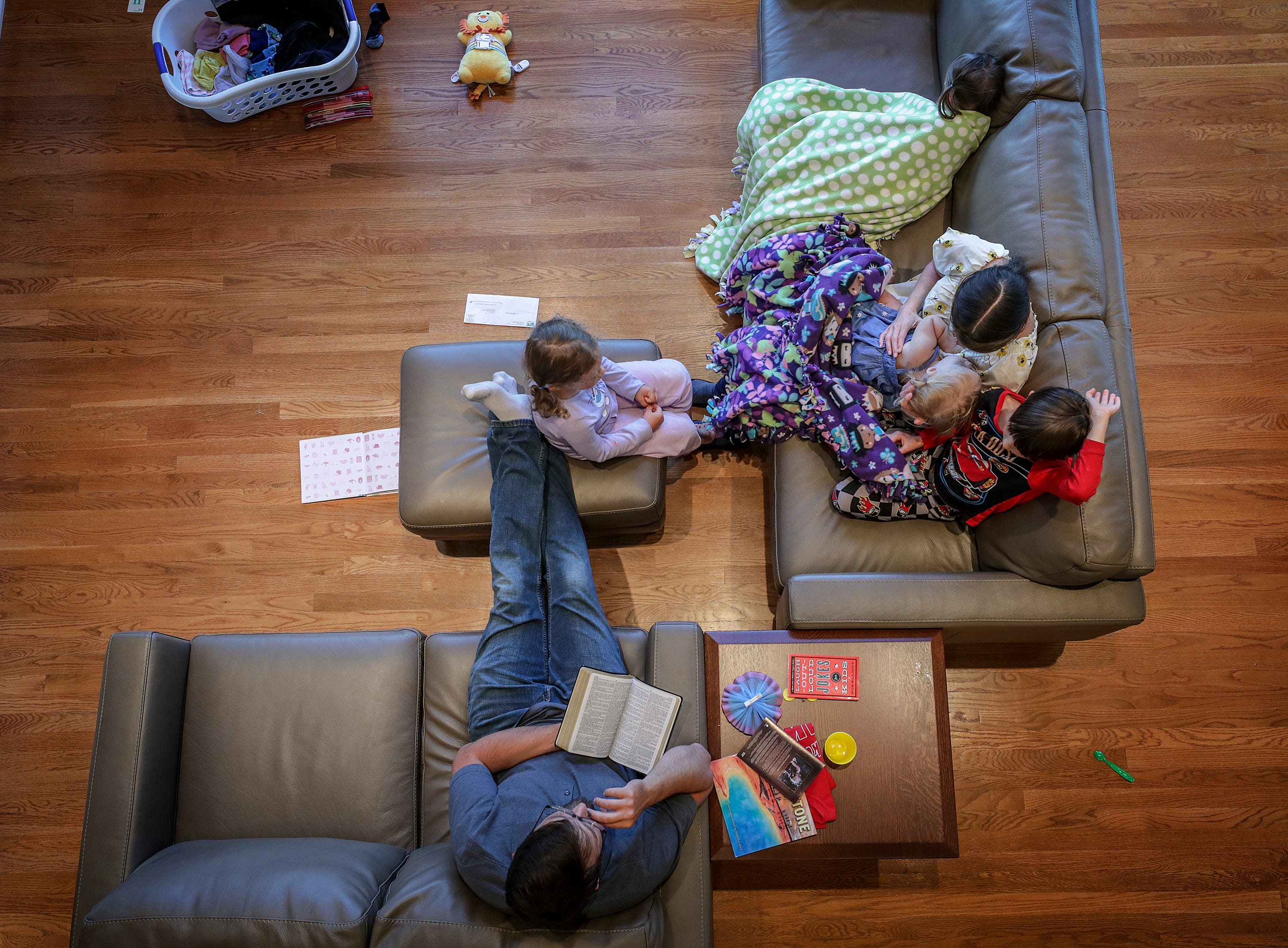 Rachael Denhollander and her husband, Jacob, share evening prayers and scripture discussion with their children.
