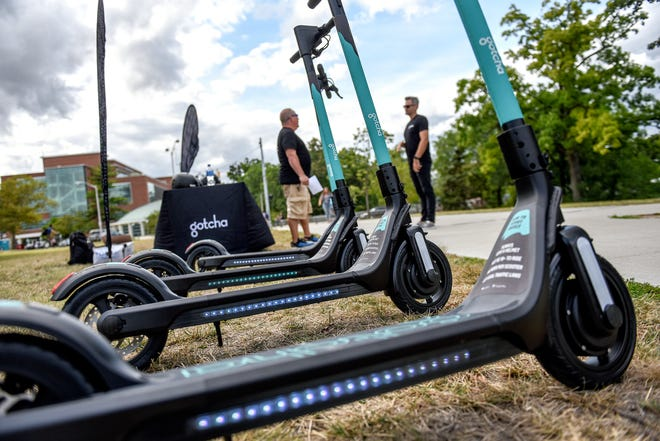 Gotcha e-scooters, photographed at a promotional booth on Wednesday, August 28, 2019, on the Michigan State University campus in East Lansing.