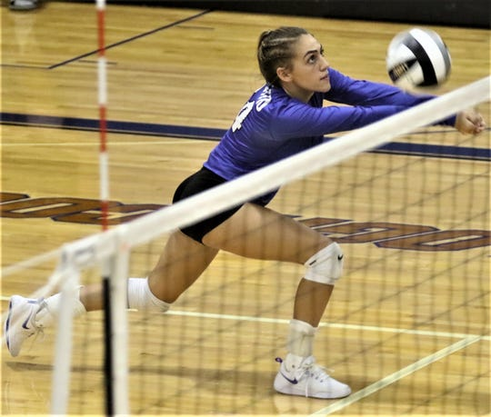 Ontario's Alexa Frankhouse keeps the ball alive for the Lady Warriors during a heartbreaking 3-2 loss on Tuesday.