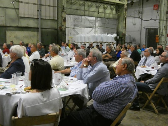 Marion community members, leaders, and elected officials listen at a lease signing event at the old Marion Power Shovel building. Ted Graham, who owns the complex, is leasing about 220,000 square feet of the complex to Enterra Feed, which plans to open a new production facility in Marion to produce feed ingredients out of insects.