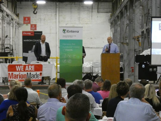 Ted Graham, right, owner and president of the Marion Industrial Center, speaks before signing a lease with Enterra Feed, which farms insects and turns them into feed ingredients, to open a new production facility in the old Marion Power Shovel building on West Center Street in Marion.