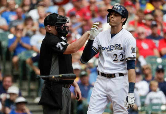 Brewers star Christian Yelich tosses his bat aside after striking out looking against Cardinals starting pitcher Jack Flaherty on Wednesday, Aug. 28.
