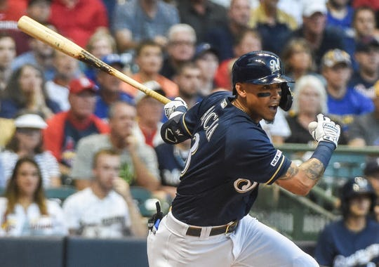 Brewers shortstop Orlando Arcia (3) drives in a run with a base hit in the second inning.