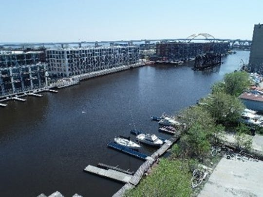 A vacant site on the Milwaukee River is again the target of a proposed housing development.