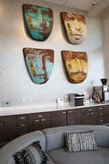 Michael Stodola's artwork featuring each of the Beatles on Volkswagen Beetle hoods hangs in the lobby of the Synergy apartments at the Mayfair Collection.