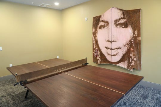 Michael Stodola put Aretha Franklin's likeness on a Cadillac hood. In 2010, the brand manager for Lakefront Brewery wanted to test out a new medium of art. This piece is in the community room at Synergy at the Mayfair Collection.