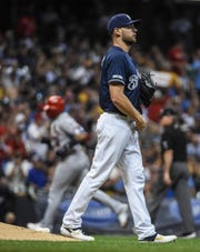 Brewers pitcher Adrian Houser gives up a solo home home run to Yadier Molina in the fifth inning.