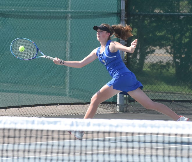 Mountain Home's Sarah Godfrey reaches for a shot during recent action.