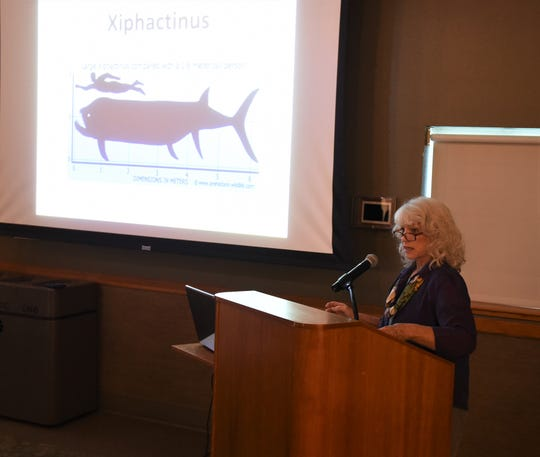 Dianna Roller of Gassville addresses the Baxter County Historical & Genealogical Society on Tuesday night about the White River Monster, which is said to live near Newport.
