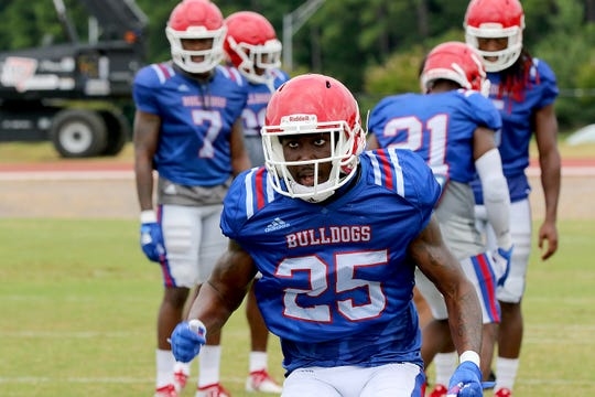 Louisiana Tech redshirt freshman Bee Jay Williamson (25) works through drills during fall camp.