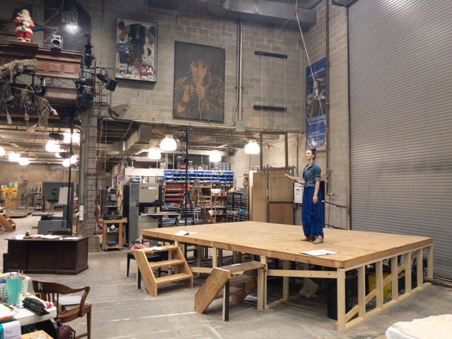 """Elizabeth A. Davis, who stars as Mary Ann """"Buzz"""" Goodbody, on stage in the scene shop at Alabama Shakespeare Festival."""