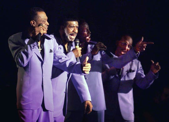 The Four Tops perform for their fans during a double bill with the Temptations at First American Music Center on Aug. 1, 1999.