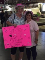 Nancy Clevenger (left) greets half-sister Tina Barbour (right) at the airport Aug. 9. The two reunited after 57 years using 23andMe.
