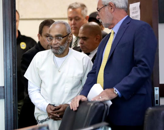 Abu-Ali Abdur'Rahman, front left, enters the courtroom for a hearing Aug. 28, 2019, in Nashville. Abdur'Rahman, who was convicted of murder, says a prosecutor's racially motivated dismissal of potential jurors resulted in an unfair trial.