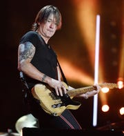 Keith Urban will perform at Stars and Strings, a military-family benefit event at Detroit's Fox Theatre.
