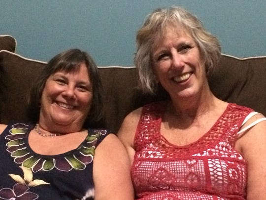 Half-sisters Tina Barbour (left) and Nancy Clevenger (right) sit in Clevenger's living room in Portland, Tenn. The two reunited using 23andMe after 57 years.