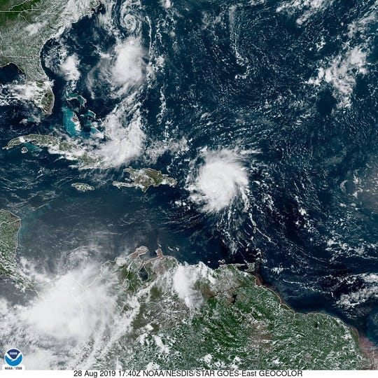 Hurricane Dorian swirls over Puerto Rico, east of Hispaniola. The storm is expected to become a Category 3 hurricane by the time it nears Florida by the weekend.