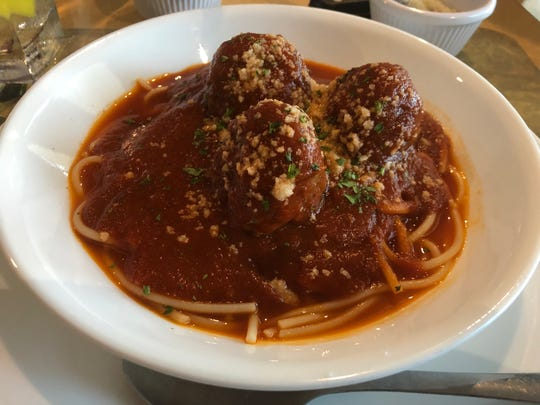 Sicilia's pasta with meatballs ($12.99) comes with a side salad and bread sticks.