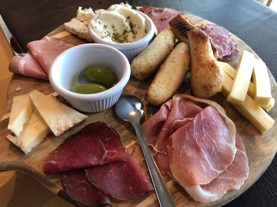 The Etna antipasti board ($22 for one person) from Sicilia in East Naples comes fresh meats and cheeses such as salami, provolone, speck prosciutto and Gorgonzola.