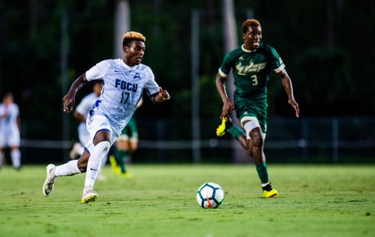 FGCU's Shak Adams advances with the ball during a game against USF last September.