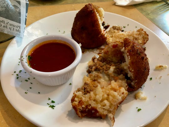 Arancino ($4.50) from Sicilia is a fried rice ball appetizer filled with ground beef and mozzarella.