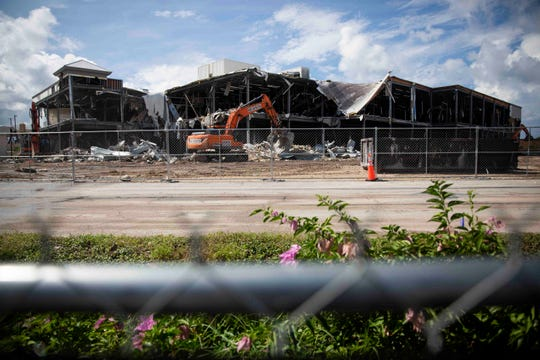 A construction crew works on the demolition of a former Sears building, which is set to be replaced with a new movie theater, at Coastland Center mall in Naples on Tuesday, August 27, 2019.