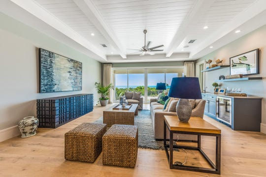 Ruta Menaghlazi and the design team at Theory Design create interior designs including the Captiva great room, shown here.