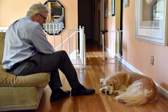 Jay Granat and his golden retriever Nate, sit in the River Vale home he shared with his wife Robin Granat, 59, on August 26, 2019. Robin, who is dying from an incurable brain tumor, wanted to end her life with lethal medication, as New Jersey's new Aid-in-Dying law allows. But a legal challenge to the law thwarted her plans. She is now in in-patient hospice –not the death she wanted.
