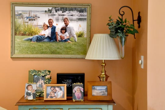 Family photographs adorn the River Vale home of Jay and Robin Granat on August 26, 2019. Robin Granat, 59, who is dying from an incurable brain tumor, wanted to end her life with lethal medication, as New Jersey's new Aid-in-Dying law allows. But a legal challenge to the law thwarted her plans. She is now in in-patient hospice –not the death she wanted.