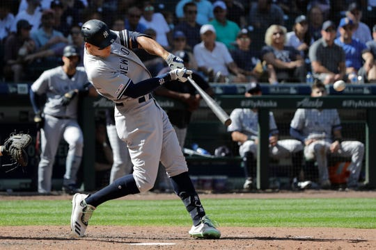New York Yankees' Aaron Judge hits a double during the seventh inning of the team's baseball game against the Seattle Mariners, Wednesday, Aug. 28, 2019, in Seattle. (AP Photo/Ted S. Warren)