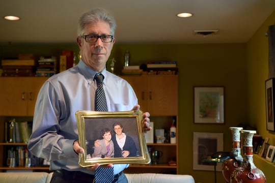 Jay Granat holds a photograph with his wife of thirty-one years, Robin Granat, who is dying from an incurable brain tumor. Robin wanted to end her life with lethal medication, as New Jersey's new Aid-in-Dying law allows, but a legal challenge to the law thwarted her plans. She is now in in-patient hospice –not the death she wanted.