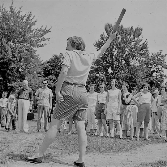 The women's rolling pin toss remains a favorite part of Holiday Oberserver's July 4 field games.
