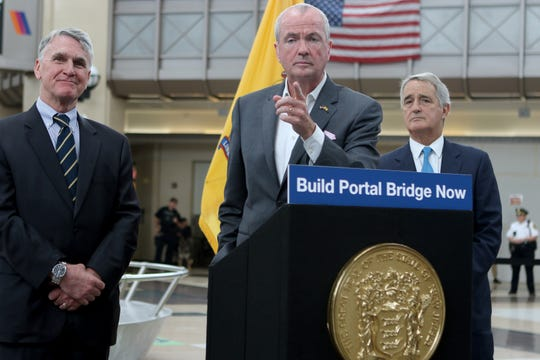 Governor Phil Murphy calls on a member of the press as he stands beside NJ Transit CEO, Kevin Corbett  and Gateway Development Corporation Chairman, Jerry Zaro at Secaucus Junction Station.  The press conference was held to highlight the importance of building a new portal bridge.  The current bridge, which is 110 years old, breaks down often and sometimes needs to be hit back into place with a sledge hammer.  The state has $600 million to put into the new portal bridge but needs more than that amount in federal funding to build the new bridge. Wednesday, August 28, 2019