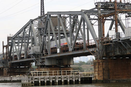 An NJ Transit train goes over the current Portal Bridge, in Kearny, above the Hackensack River. Thursday, October 4, 2018