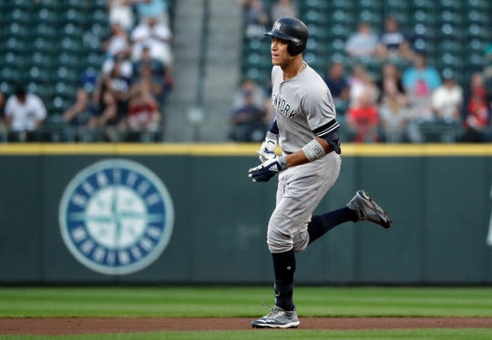 New York Yankees' Aaron Judge rounds the bases on his two-run home run against the Seattle Mariners during the first inning of a baseball game Tuesday, Aug. 27, 2019, in Seattle. (AP Photo/Elaine Thompson)