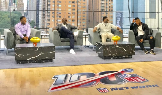 Pro Football Hall of Fame running backs (l to r) Barry Sanders, Terrell Davis and LaDainian Tomlinson share the stage with NY Giants running back Saquon Barkley at the NFL 100 kickoff event at Jazz at Lincoln Center on Tuesday night in New York.