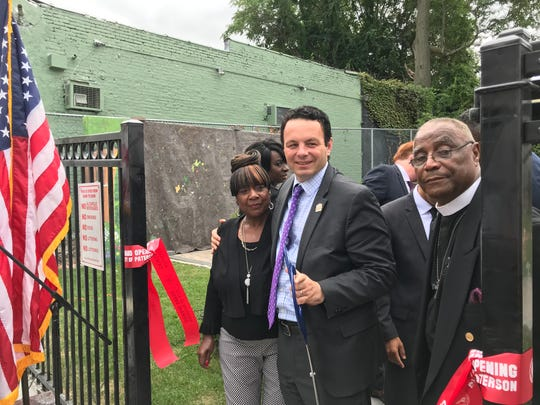 Paterson Mayor Andre Sayegh is flanked by city councilwoman Ruby Cotton ( L ) and Rev. Allan Boyer, pastor of Bethel A.M.E. Church.