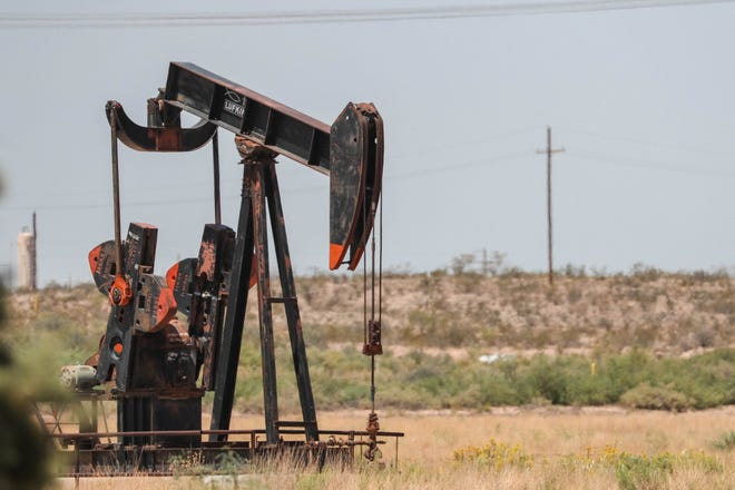 A rig pumps oil near Carlsbad on Wednesday, Aug. 21, 2019. New Mexico's increase in state revenue is linked to steadily growing oil and natural gas production in the Permian Basin that straddles New Mexico and Texas.