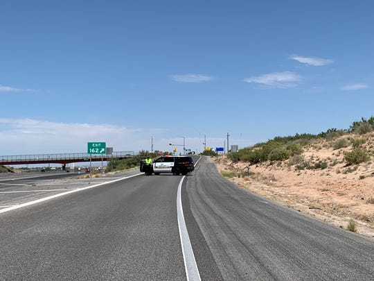 Authorities block Exit 162 to NM 404 on Wednesday, Aug. 28, 2019.